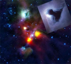 Ein echtes Loch in einem Reflexionsnebel und nicht etwa eine dunkle Globule ist das T-förmige Etwas (oben, in der grünlichen Wolke) inmitten von NGC 1999. Erst der Infrarot-Satellit Herschel (großes Bild, bei 70µm und 160µm, kombiniert mit 1,6µm und 2,2µm von der Erde aus) konnte nachweisen, dass dort tatsächlich nichts ist – einem bekannten Bild des Hubble Space Telescope (klein) kann man dies trotz seiner viel größeren Schärfe nicht entnehmen. [ESA/HOPS Consortium, Inset: NASA and The Hubble Heritage Team (STScI)]