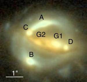 Das Gravitationslinsensystem B1608+656, aufgenommen mit der ACS-Kamera des Hubble Space Telescope: Die Bilder der Quellgalaxie sind hier mit A-D bezeichnet, die beiden Linsengalaxien mit G1 und G2. [NASA/STScI, ESA, S. H. Suyu (University of Bonn), P. J. Marshall (Stanford University)]